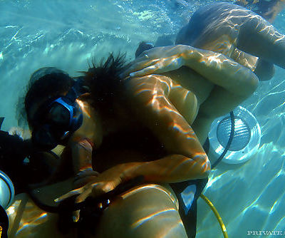 Asian scuba diver gives a BJ..