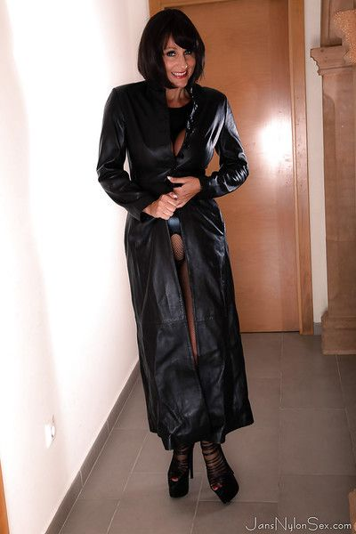 Busty European lady Jan Burton flashing big tits under leather coat