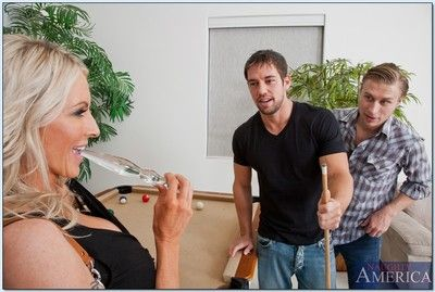 Naughty mature babe Emma Starr gets fucked by two hard cocks