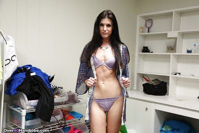 Older brunette chick in lingerie and heels demonstrates handjob technique