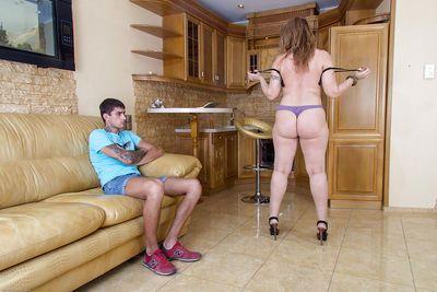 Big butt cougar Dana Karnevali exposes her high heeled body to young stud