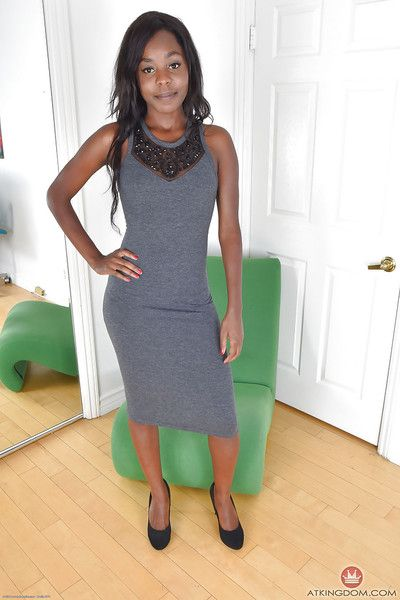 Older ebony lady hikes dress to reveal nice round and brown ass