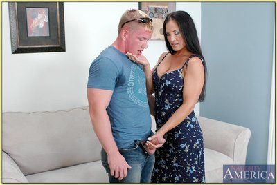 Mature brunette with big tits Angel Caliente got her pussy stuffed hard