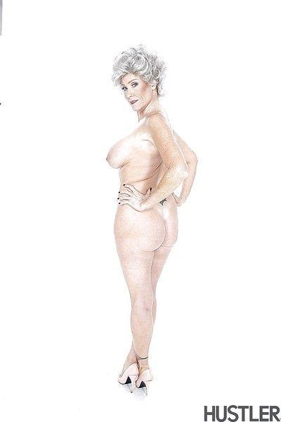 Mature pornstar Darla Crane showing off massive granny hooters