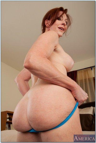 Mature redhead Catherine de Sade masturbating gently on cam