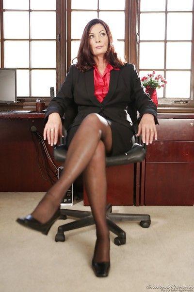 Older office worker Magdalene St Michaels undresses for nude photos