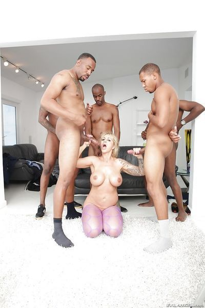 Mature blonde lady Ryan Conner undergoes interracial gangbang and blowbang
