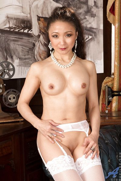 Asian mature Kim is demonstrating her sexy body in white stockings