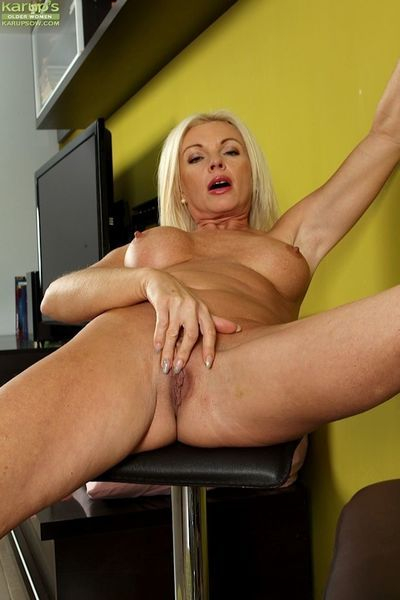 Aged blonde babe Casey Szilvia freeing big boobs and spreading pussy - part 2