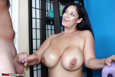 Busty older lady grabs hold of thick prick and cruelly jacks it off