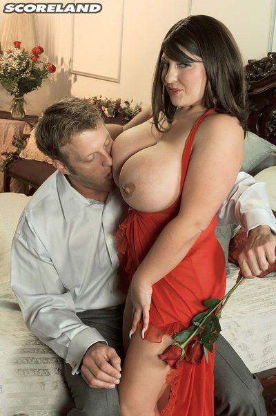 Pierced huge titted Angel Gee in sheer lingerie giving handjob & masturbating