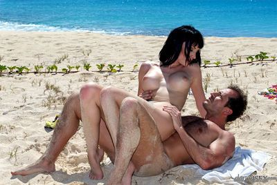 Tattooed MILF pornstar Sofia Valentine giving BJ on beach before doggy sex - part 2