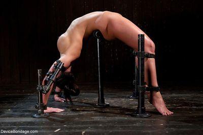 Buxom MILF Phoenix Marie bent over backwards in hardcore bondage shoot