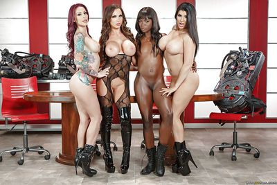 Black and white pornstars in boots model naked on desk in all girl orgy