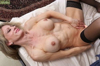 Older lady Christina Brim toying her aged pussy with ribbed vibrator - part 2