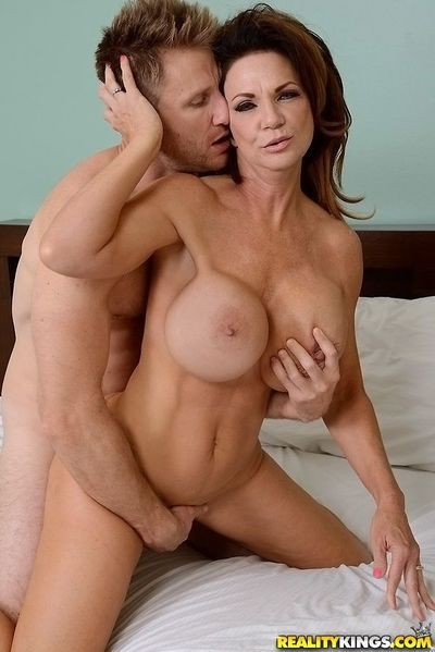 Top-heavy cougar gets fucked hardcore and jizzed over her rack - part 2
