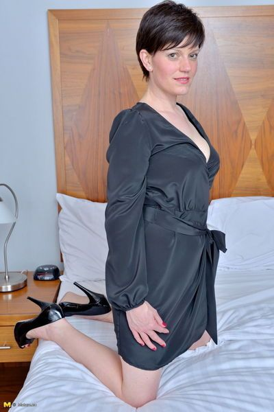 Short haired housewife from Britain slips off robe and lingerie to pose naked