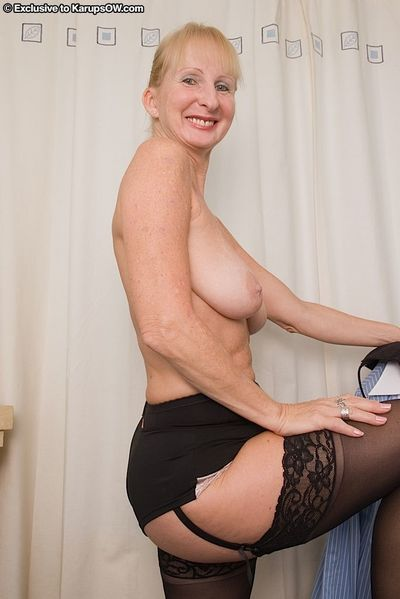Lusty granny with saggy tits and ample butt getting nude in the office