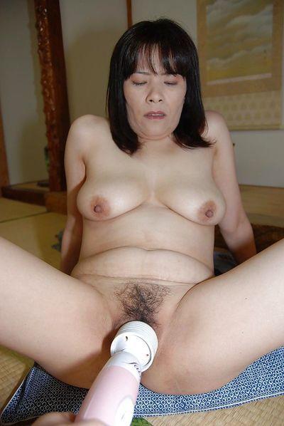 Awesome mature asian with big tits Yumiko masturbatin pussy