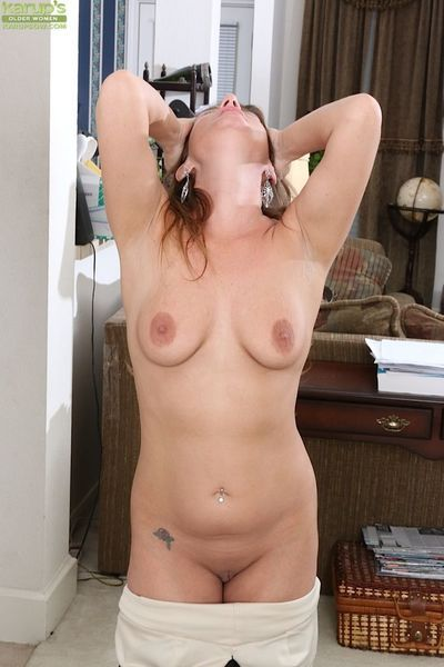 Mature woman Chase Cunningham undresses for spreading of shaved pussy