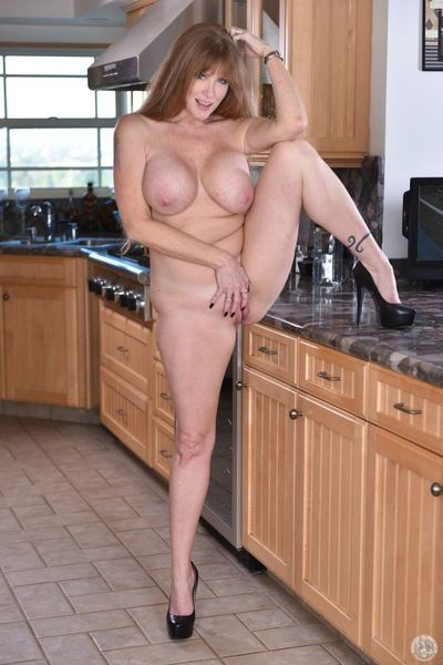 Darla Crane shows off her mature body when finger fucking alone in the kitchen