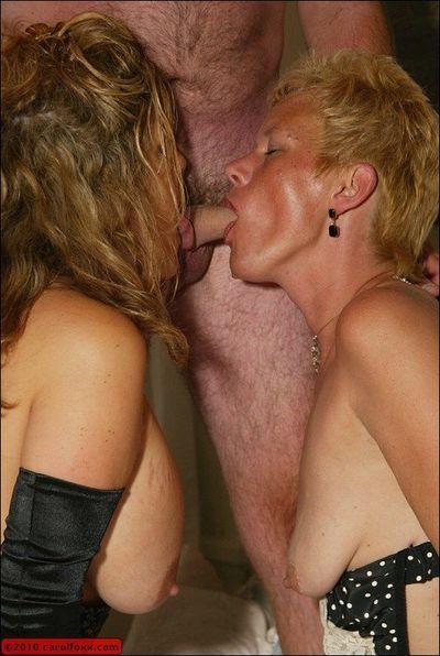 Carol Foxxx and her mature fatty girlfriend smoking and sucking a big cock