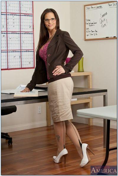 Mature teacher with glasses Syren De Mer poses in expensive lingerie.