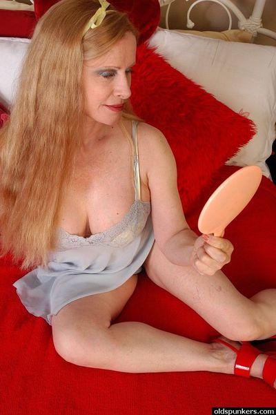 Older broad Lavender undresses in bedroom to reveal massive knockers