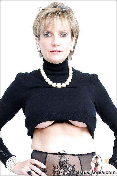 Clothed mature Lady Sonia shows her stunning big natural boobies