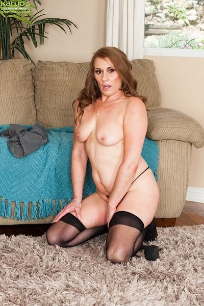 Mature wife in stockings Cristine Ruby doing a striptease at home