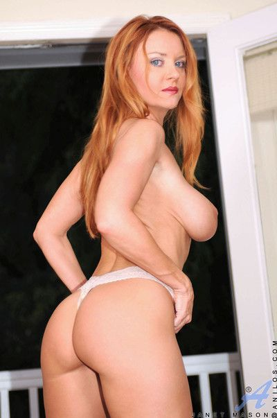 Blue eyed red head shows off her gigantic tits