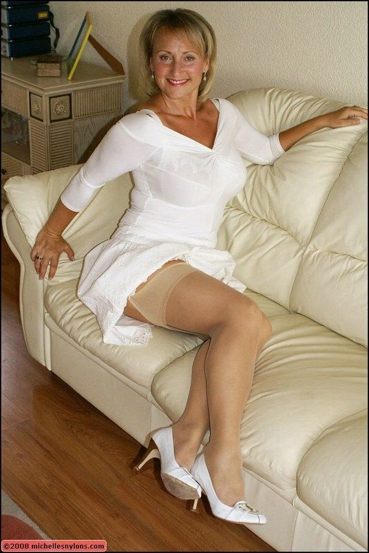 Old lady in white stockings and lingerie spreading and masturbating on the couch