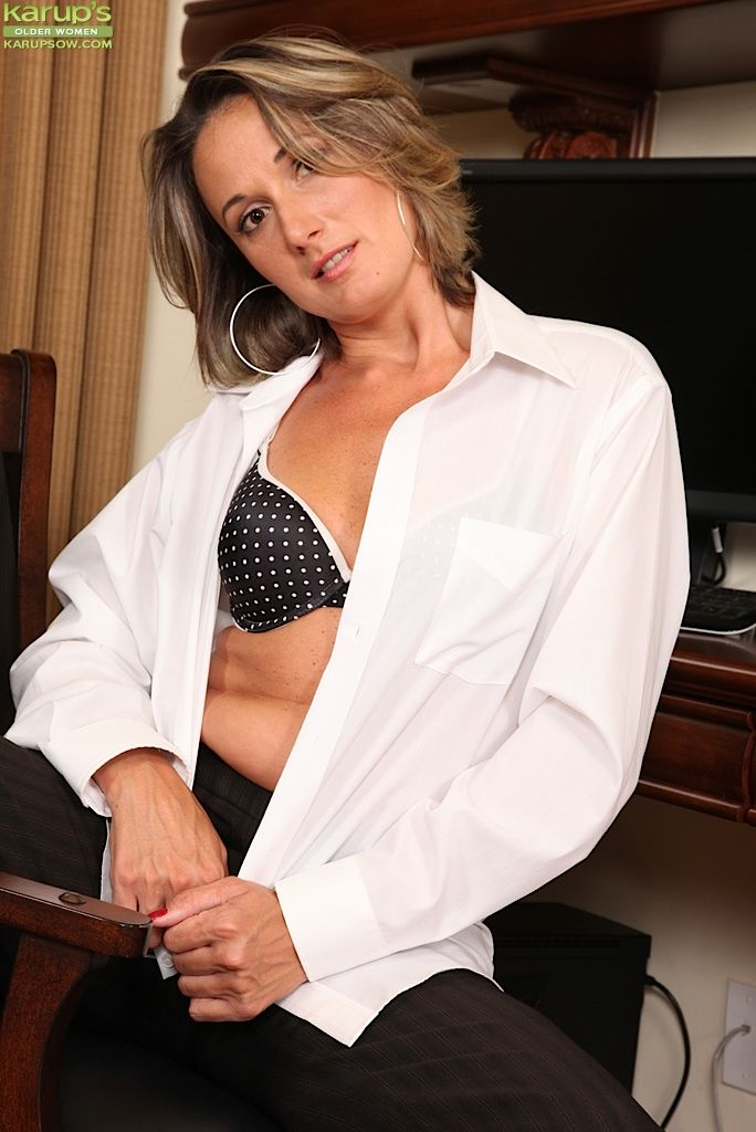 Mature mom Misty Law strips sexy panties and exposes tiny tits in the office
