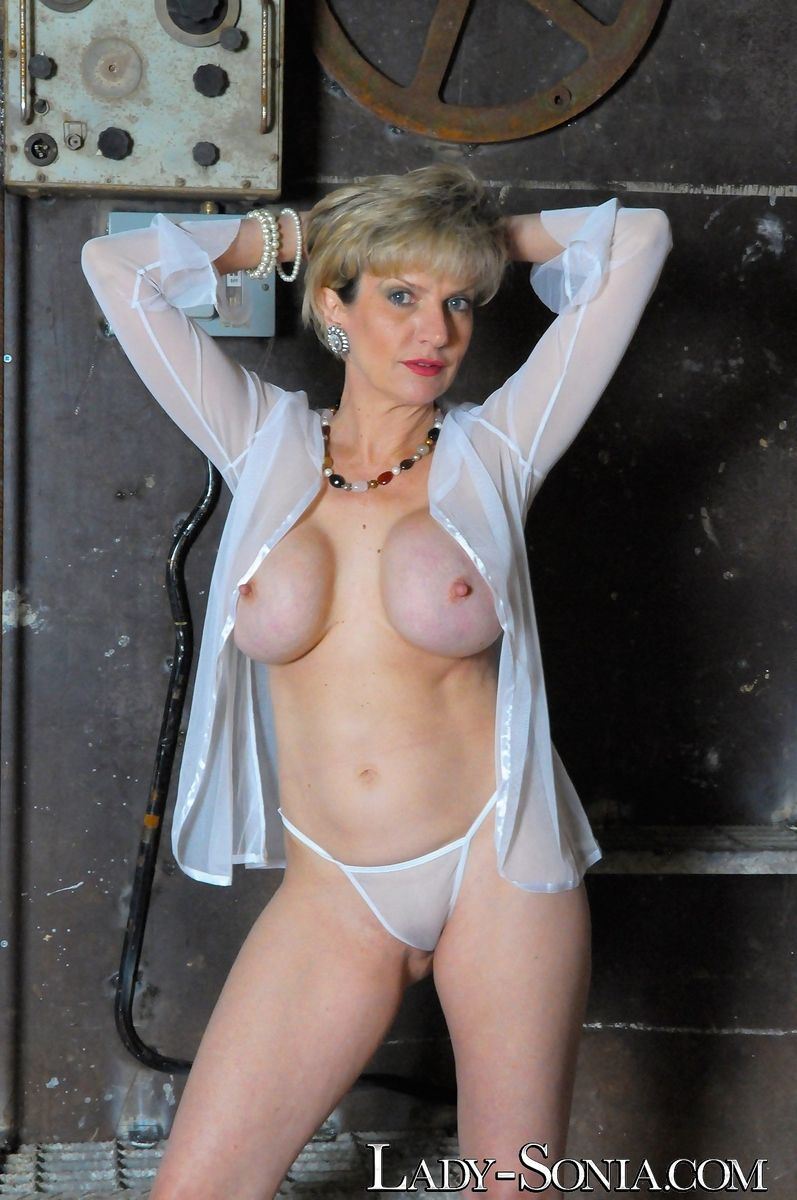 Sexy blonde mature MILF Lady Sonia flaunting her firm ass & big fake tits