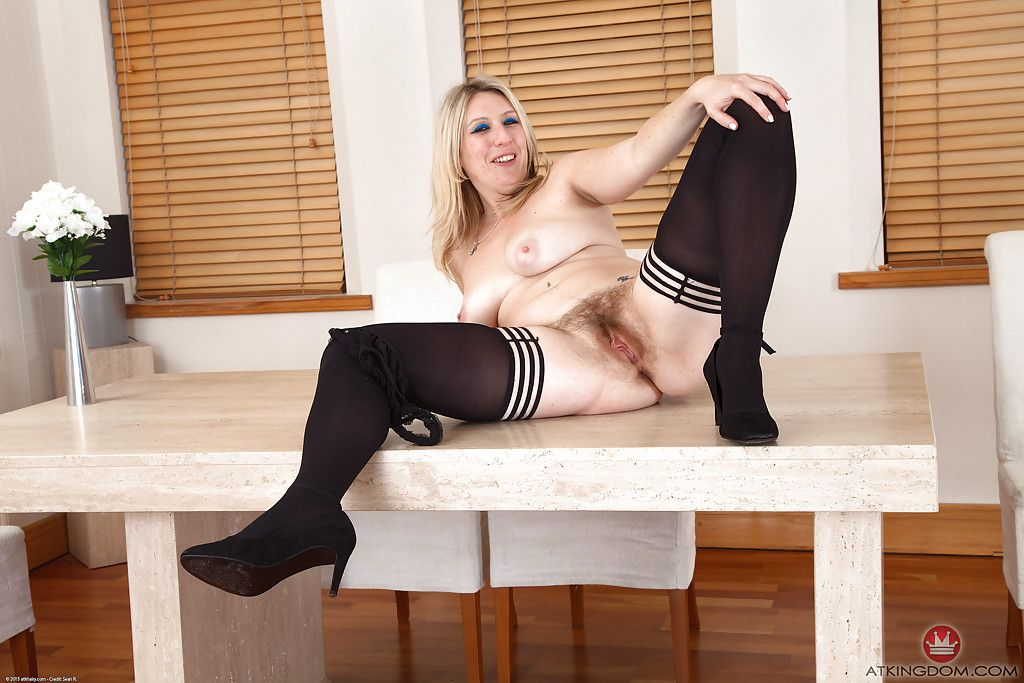 Aged solo model Mel Harper exposing all natural pussy atop kitchen table