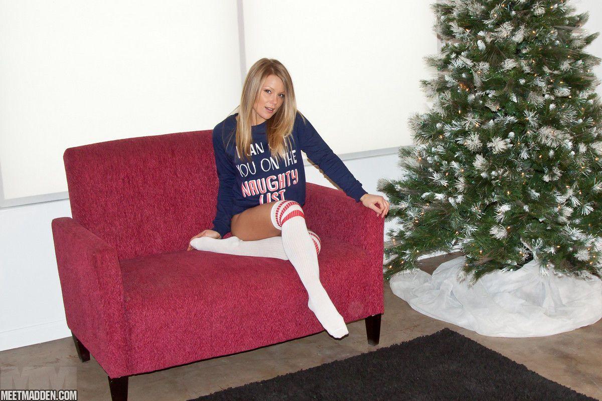 Cute solo girl Meet Madden strutting in over the knee sport socks