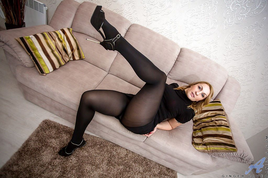 Older babe Ginger Love posing non nude in black pantyhose and heels