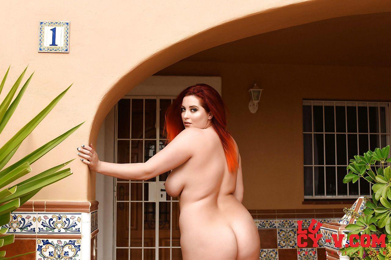 Plump mature redhead Lucy Vixen flashes naked upskirt & bares huge tits & ass