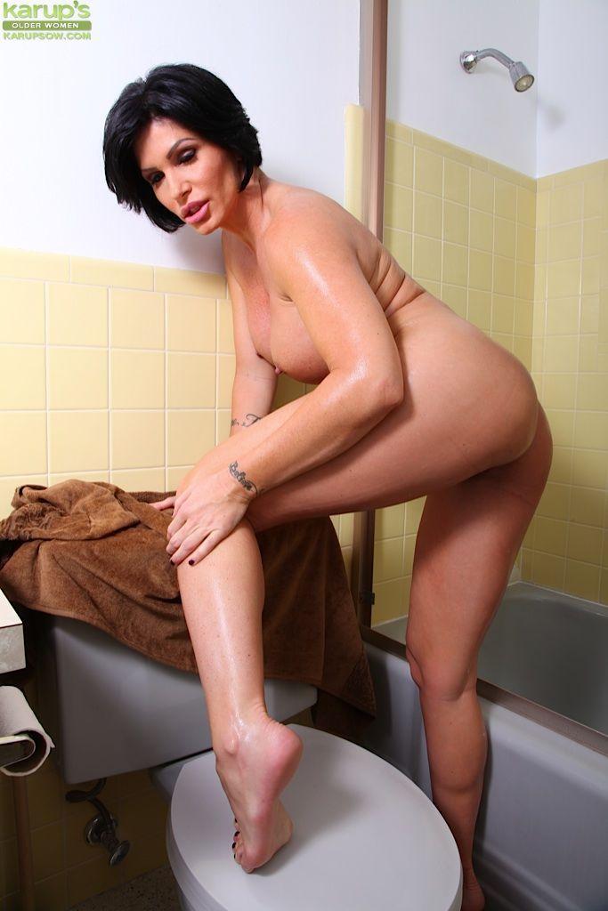 Slutty pornstar Shay Fox taking shower and working with shaved snatch