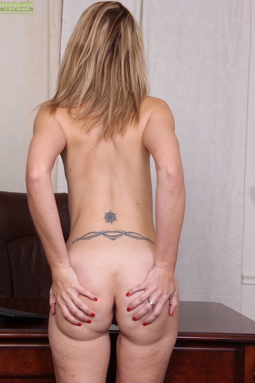 Older boss lady Heidi Van Moore strips and shows off her moist pussy in office