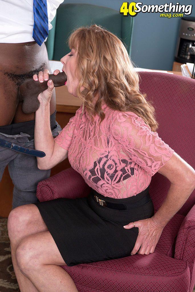 Mature blonde sucks a huge black cock and eats jizz in a hot interracial play