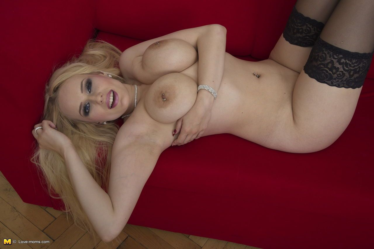 Hot blonde mom teasingly whips out knockers and licks her pierced nipples