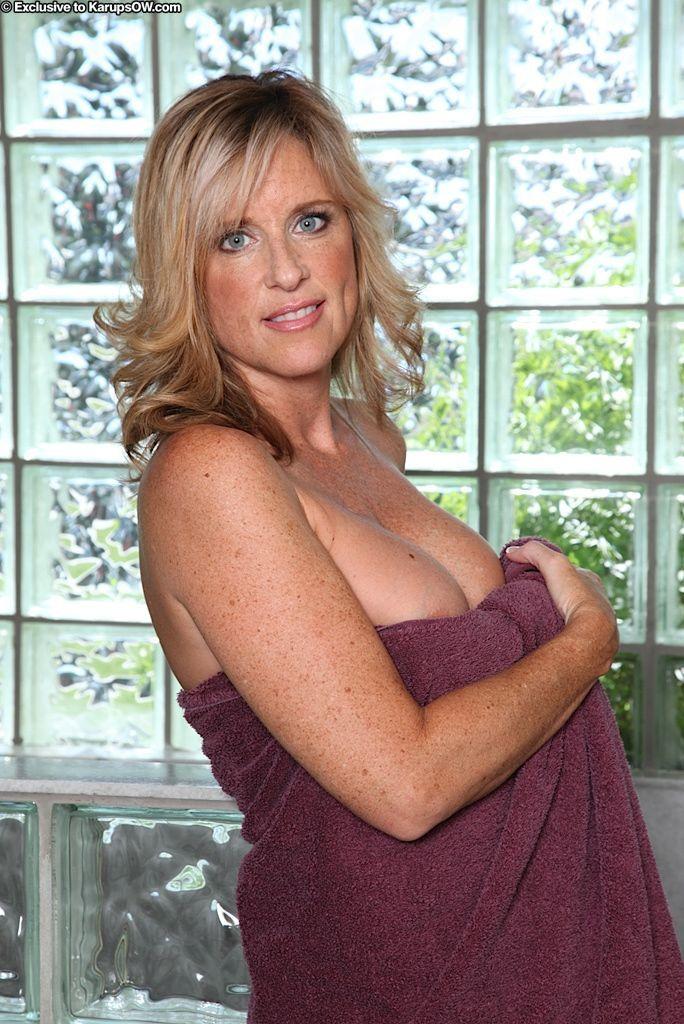 Mature woman Jodi West demonstrating big tits while masturbating in shower