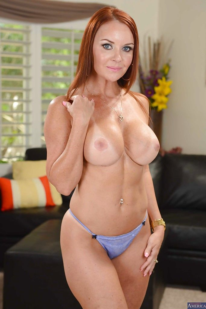 This redhead mature wife Janet has hairy pussy that she wants to show