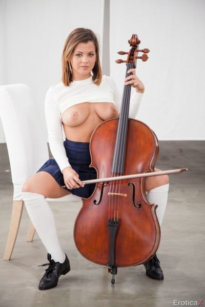 Cute girl Keisha Grey shows off big natural tits and twat during cello lessons
