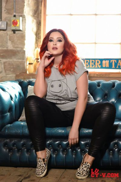 Fat redhead Lucy V uncovers her huge all natural tits in leather pants