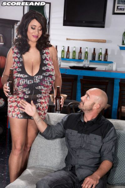 Sexy brunette Roxi Red seduces her man with her massive hooters