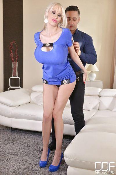 Chesty blonde Euro MILF Sandra Star tit fucking and sucking cock on knees