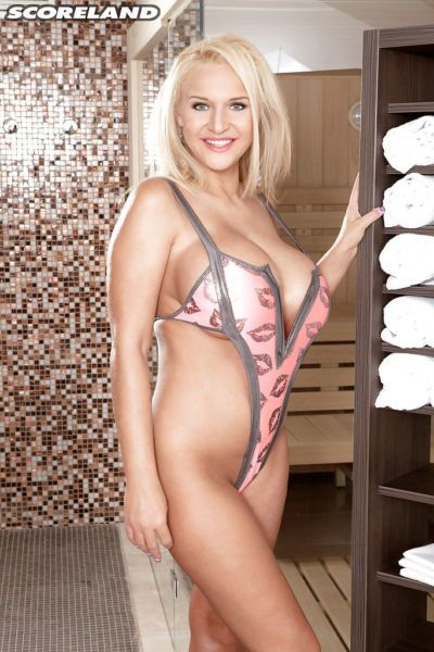 Blonde Euro babe Dolly Fox baring huge hooters before masturbating