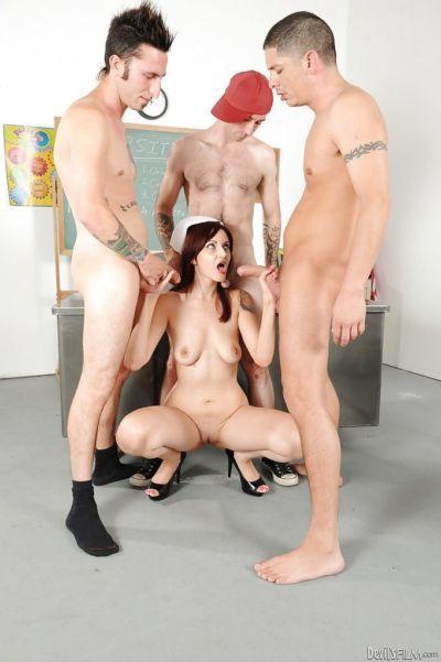 Lustful nurse Phoenix Askani gets banged hardcore by three horny guys